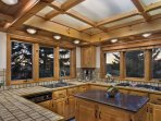 Kitchen with Granite Island, large range with griddle