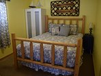 Bedroom with queen bed and fire engine toddler bed