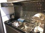 Kitchen w/ standard cooking utensils