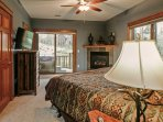 Master bedroom with walk out to private hot tub