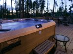 Sink into your private hot tub under the setting sun