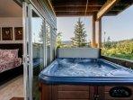 Soak in the private hot tub