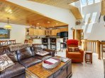Main level skylight cascades through this bright and open townhome