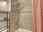 Shower/Bathtub Combination - Water closet with a shower/bathtub combination.