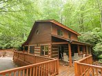 This cozy two bedroom plus loft log cabin is charming and private with all extras including hot tub, wood-burning...