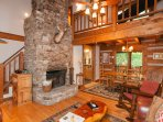 The hand-hewn authentic logs, the hardwood heart of pine floors, the 30 ft. stacked stone wood-burning fireplace...