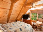 Enjoy the view of the surrounding forest from the upstairs bedroom.