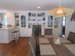 Another view of the Dining room -wine frig available for your pleasure-(off to the right is the master bedroom on the...
