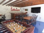 Bar, TV, foos-ball and dining room table for those nights when you might need to eat inside.