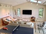New game room with ping pong, plentiful seating and a second TV area