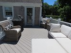 Just off the kitchen is this cozy deck with gas grill