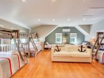 Huge bunk room located above the garage and away from the rest of the home