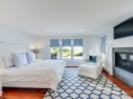 Here is the first floor master bedroom with a luxurious king size bed and views of the water.