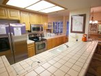 Large kitchen is open to living and dining rooms