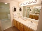 Master bath has double sinks, tub/shower combo and toilet