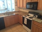 Spacious kitchen with coffee maker. Make lunches to go and enjoy on the beach!