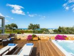 Panoramic sea view can be enjoyed while relaxing on the sun beds or in the Jacuzzi