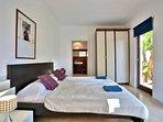 Ground floor double bedroom with en-suite bathroom and door to terrace