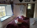 The main bedroom is en suite and looks out onto the garden.Dressing gowns are there for the hot tub.