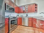Whip up your favorite recipes in the fully equipped kitchen adorned with stainless steel appliances.