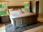 The master bedroom offers a king size bed and French doors leading to the verandah.