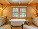 The private bathroom for master bedroom #1 has a clawfoot tub and separate shower.