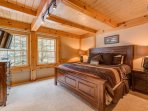 The main level master bedroom has a TV and private bathroom.