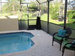 Our private heated pool faces west with cushioned love-seat and two lounge chairs.