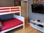 Upstairs- Entertainment bedroom with top-twin bed and bottom-full bed.  Large TV with PlayStation 4.