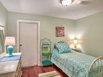 The second bedroom is furnished with a soothing teal theme.