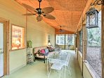The screened-in porch offers a great spot to catch the evening breeze.
