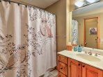 The second lower-level bathroom has a shower/tub combo.