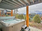 This luxury home boasts stunning mountain views from the wraparound deck and patio with private hot tub.