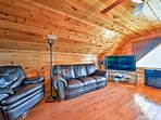 Watch your favorite show on the flat-screen cable TV in the garage loft which also features a leather couch and leather...
