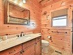The en-suite master bathroom offers a walk-in shower.