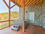 Take a soothing soak in the private hot tub on the deck overlooking the Blue Ridge Mountains.