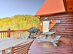 Enjoy a family barbecue on the deck with a gas grill, 2 large picnic tables, and plenty of seating.