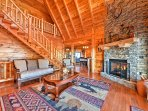Enter this lavish log cabin and marvel at the cathedral ceilings and forest views.