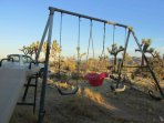 Swing set fun for smaller guests