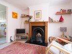Relax in front of the fire in our cosy holiday cottage, logs provided