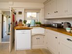 Full size smeg dishwasher and butler sink.  Lots of sharp knives and utensils