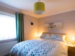 Spacious main bedroom with very comfy kingsize bed, feather duvet and Scion or John Lewis bedding