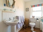 Seaside themed family bathroom, full size bath and powerful shower.  Endless hot water