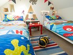 A den kids love with lots of toys and books and colourful bedding to suit age