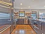 Chef's Fully Equipped Kitchen with New Stainless Steel Appliances, Including a 4-Burner Gas Range and Beautiful...