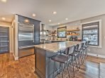 New Chef's Kitchen with Stainless Steel Appliances, Quartz Countertops, Bar Seating and Old Town Views