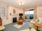 The lounge has comfortable leather furniture, a 32' TV with DVD player and a DAB radio.