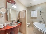 En-suite bathroom with bathtub