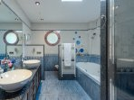 En-suite bathroom with bathtub and shower cabin