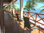 The full length balcony is the perfect spot to enjoy the sparkling Caribbean.